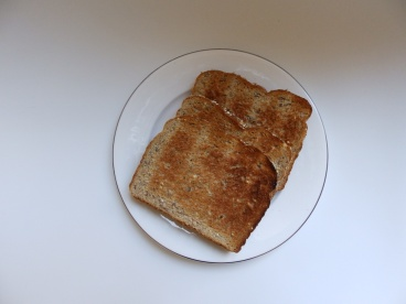 Plate with Three Slices of Brown Toast